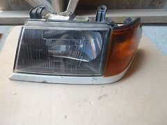 97-99 MITSUBISHI MONTERO SPORT FACTORY LEFT HEAD LIGHT HEADLIGHT AND SIGNAL - USEDPARTSRUS