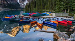 Colourful Paluski canoes at Moraine Lake, Alberta.