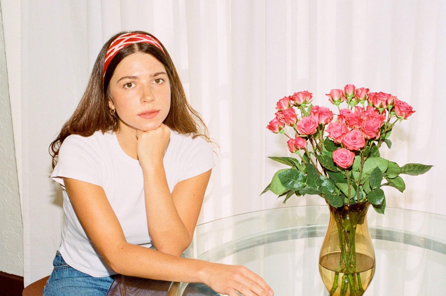 Ariel Maroko sitting at a table with flowers