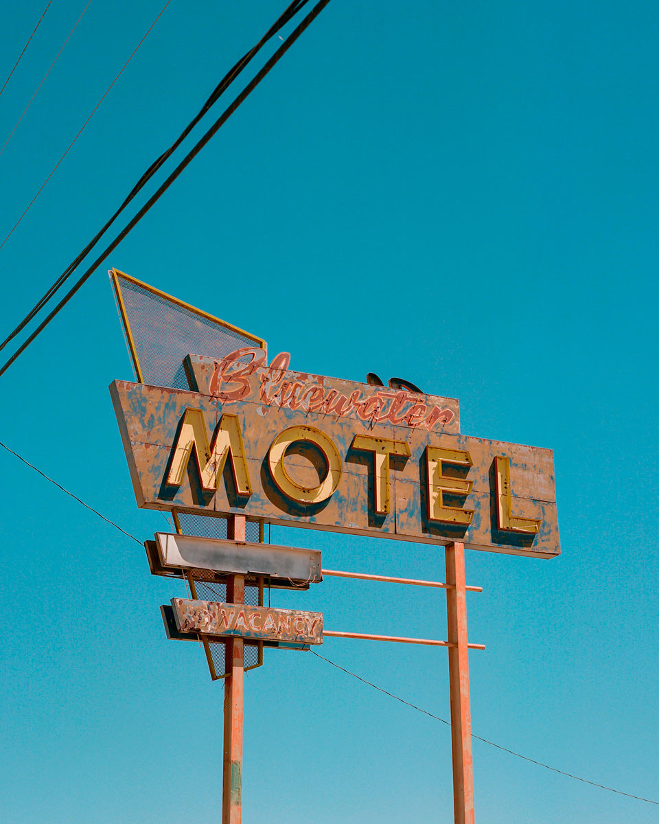 Vintage motel sign against blue sky