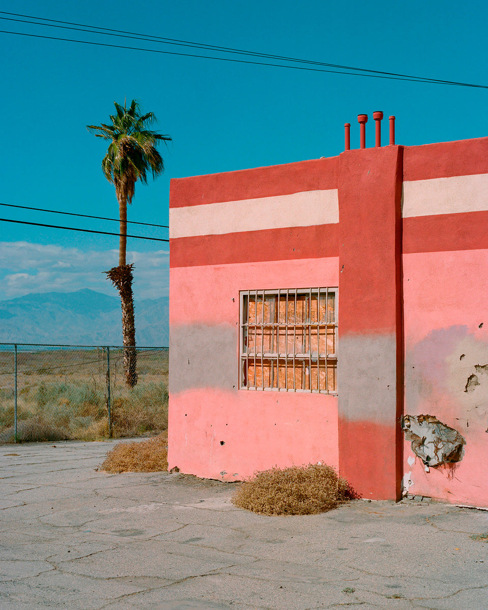 Abandoned roadside attraction in desert