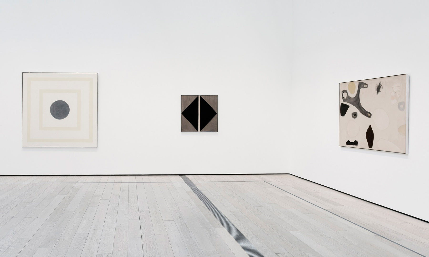 Three artworks by Agnes Martin hanging in gallery