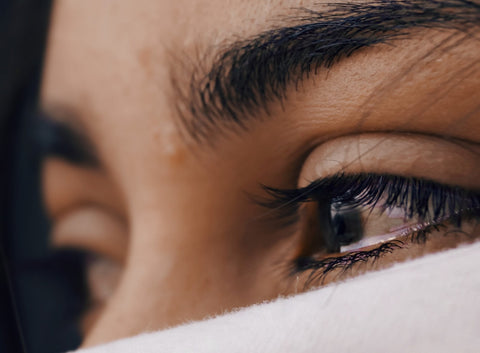 a woman with tears in her eyes