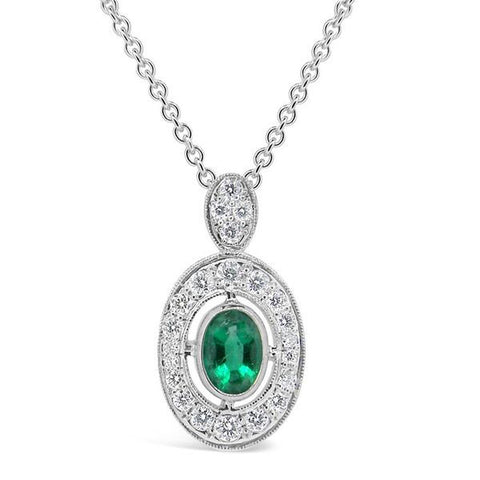 oval emerald and diamond halo pendant