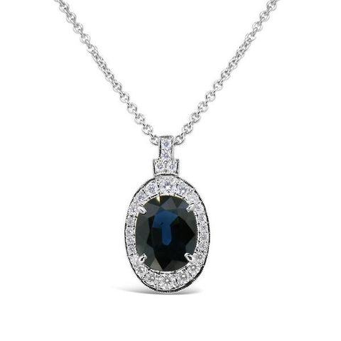 Australian sapphire and diamond halo pendant by Imp Jewellery