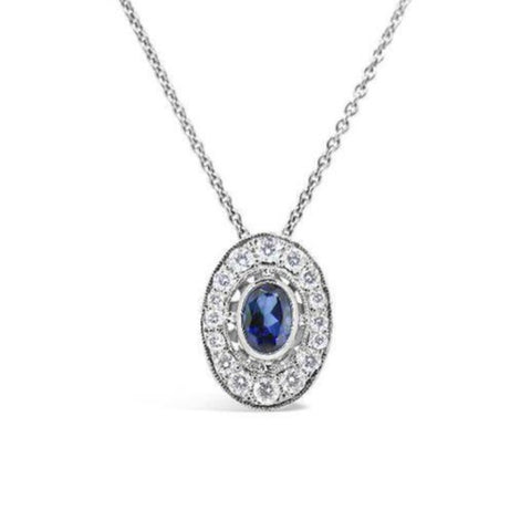 Oval Ceylon sapphire and diamond 'halo' pendant   WPP40