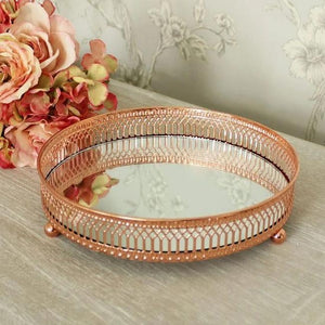 mirrored candle plate copper coloured on side table