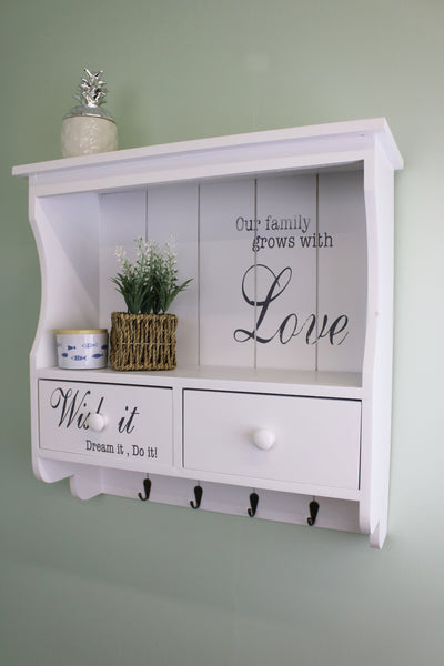 White Wall Unit with Hooks and drawers hung on the wall in use