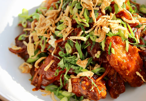Chili Chicken Wings Topped With Crunchy Shallots and Scallions