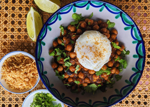 Bowl of Smoki chickpeas topped with a poached egg