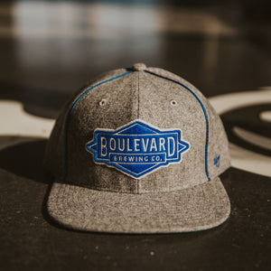 Gray wool hat with embroidered Boulevard Diamond logo patch.