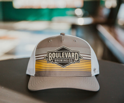 Gray hat with white and yellow stripes embroidered with  Boulevard Brewing Co. diamond logo.