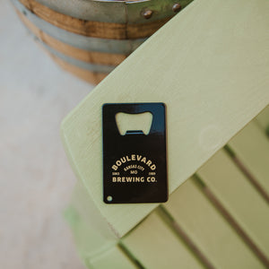 Boulevard arch card opener sitting on a chair.
