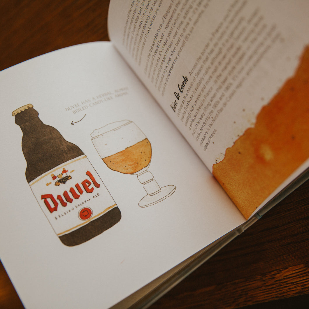 page inside book displaying illustration of Duvel beer bottle and glass