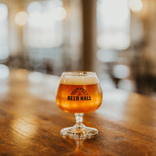 "Load image into Gallery viewer, Stemmed 5 oz. glass with ""Boulevard Brewing Co. Beer Hall"" on bar top with beer"
