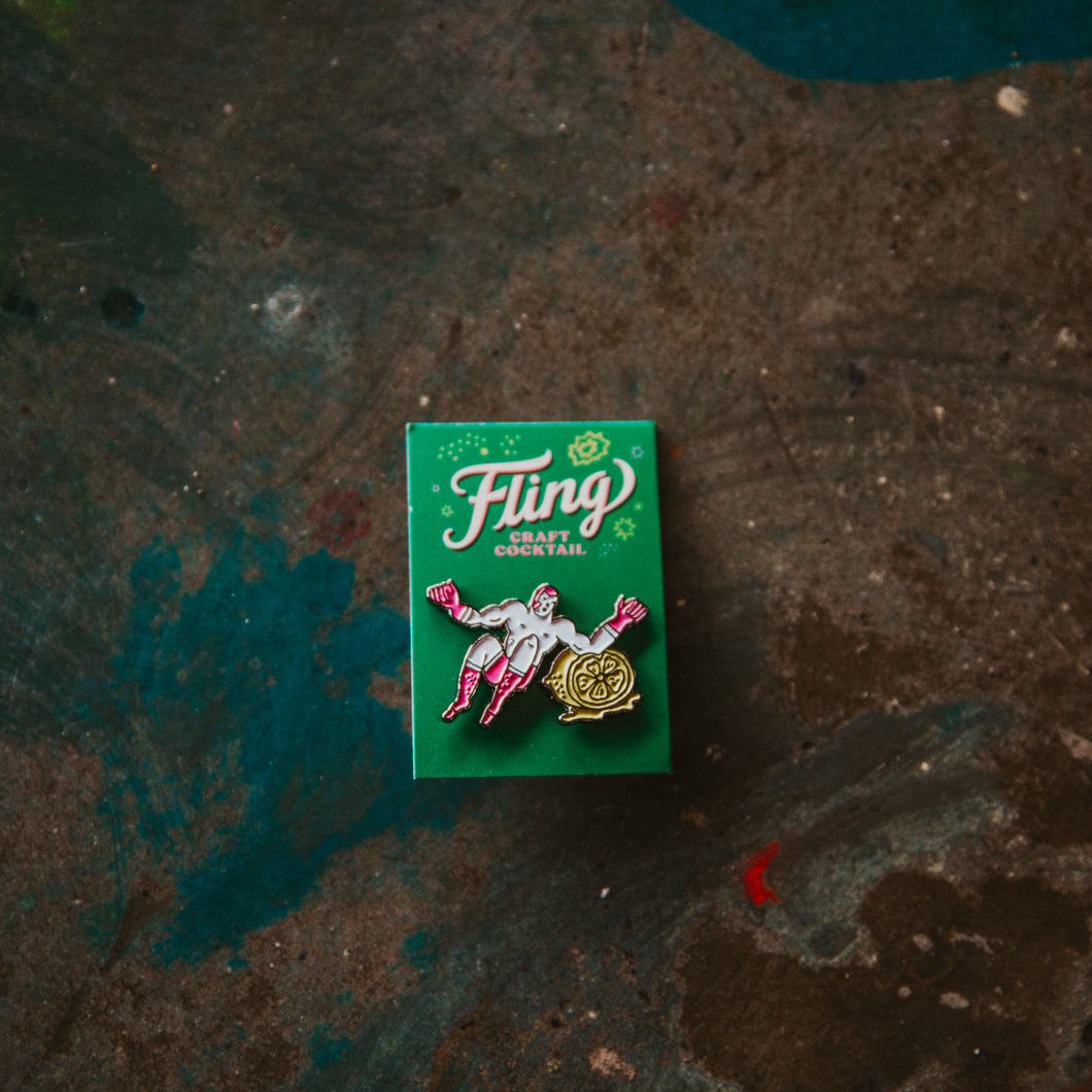 Fling Margarita enamel pin with a luchador elbow dropping on a lime