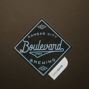 "Navy diamond shaped sticker with "" Kansas City Boulevard 1989 Brewing Co"""