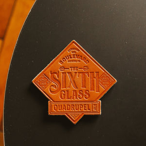 The Sixth Glass Leather Coaster top