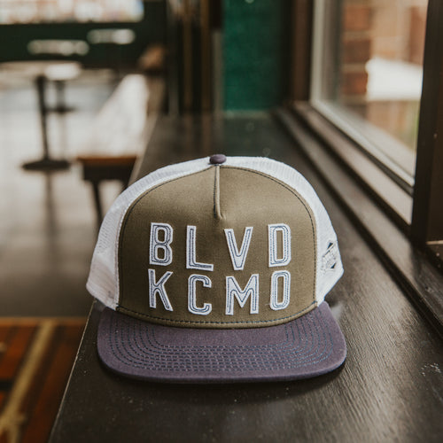 BLVD KCMO Snapback front sitting on table