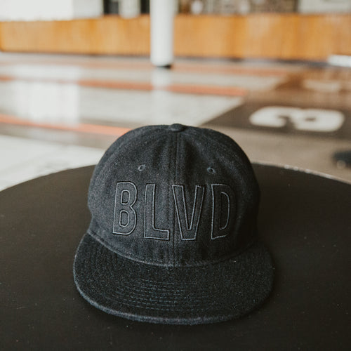 BLVD Black Wool Cap front laying on table