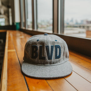 BLVD Gray Wool Cap front sitting on table