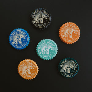 6 bottle cap style magnets in various colors  Dark background on