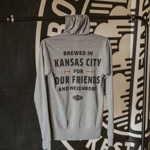 Backside of grey zip up hoodie with text