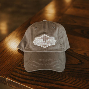 Diamond Logo Dad Cap in charcoal on table
