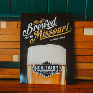 """Proudly Brewed in Missouri"" on rectangle tin tacker"