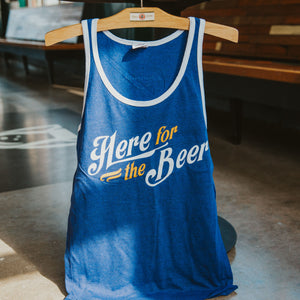 "Navy tank with white trim ""Here for the Beer"" on front."