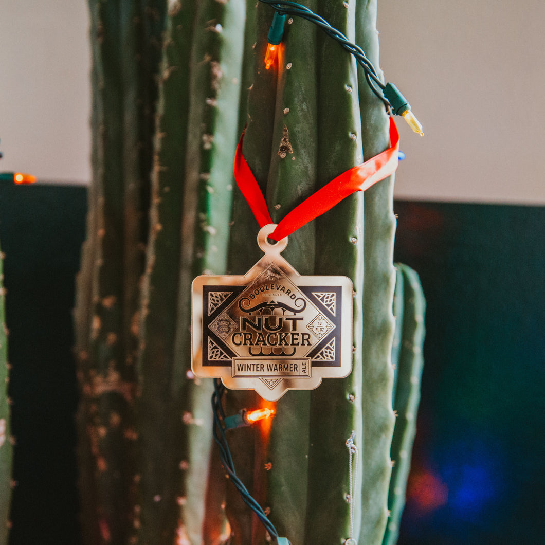 Nutcracker gold ornament hanging from cactus