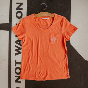 Women's Adore Pocket Tee Tigerlily laying