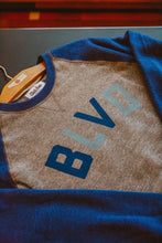 Load image into Gallery viewer, Charlie Hustle BLVD Royal Crewneck Laying Front Zoomed