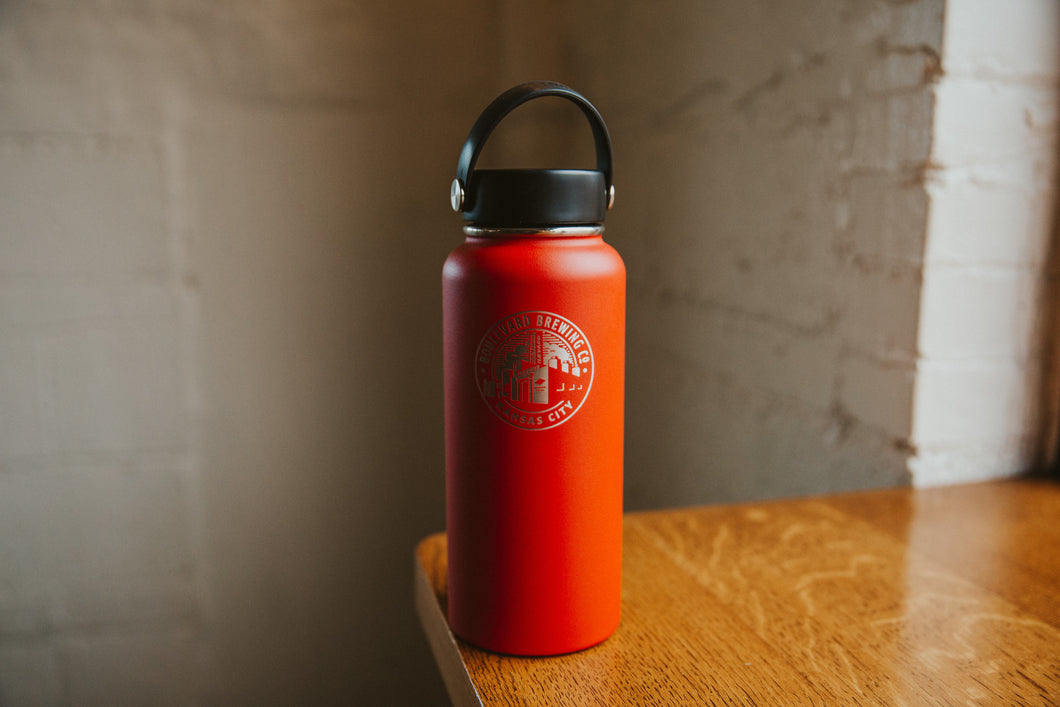 Hydro Flask 32oz Red sitting on table