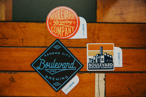 Boulevard Red Sticker, Boulevard Square Sticker and Royal Boulevard Sticker on wood background
