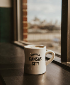 Brewed in KC Mug side with coffee