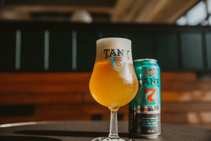 Tank 7 SS Stem Tulip Glass with beer and can