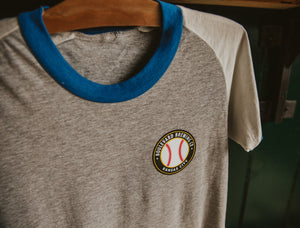 Women's Relief Pitcher Tee Hanging Front Zoomed
