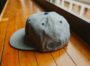 BLVD Gray Wool Cap side sitting on table