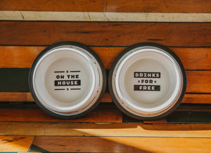 "2 dog bowls with ""On the House"" or ""Drinks for Free"""
