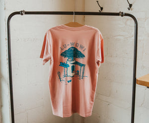 "Backside of pink t-shirt with a can tiki hut and ""Lu-WOW!"" image"