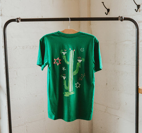 Backside of green t-shirt printed with an image of a catus with 3 arms holding 3 margaritas.