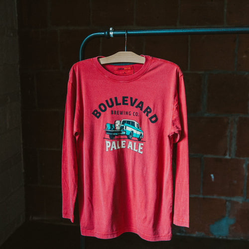 Faded red long sleeve shirt with image of a teal pickup truck with a keg in the bed and