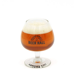 Beer Hall Logo Tasting Glass with beer and white background