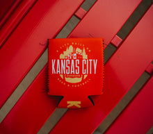 Load image into Gallery viewer, Kansas City Football Koolie laying on a red bench.