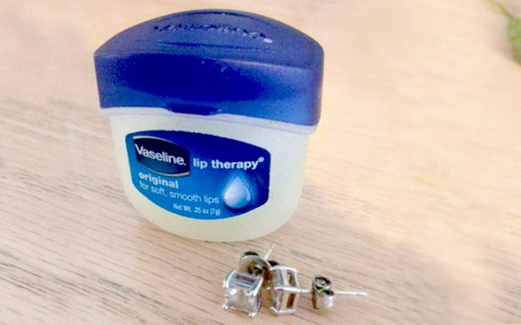 Apply vaseline to protect ear lobes