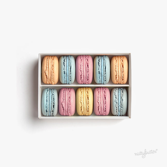 Nuttybutter box of 10 macarons. Flavours include our Nuttybutter blueberry macaron, Nuttybutter strawberry macaron, Nuttybutter lemon macaron, Nuttybutter blood orange macaron.