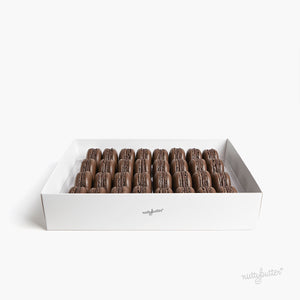 Elegant box of Nuttybutter's dark cacao macarons. This box includes 32 Nuttybutter dark cacao macarons.