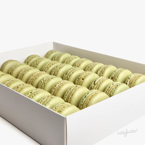 A gorgeous event box with 32 Nuttybutter french macarons. This box includes Nuttybutter's Sicilian pistachio macarons.
