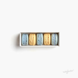 An elegant macaron gift box. This Nuttybutter gift box features three blueberry macarons and two lemon macarons.